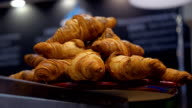 Croissants of brown and golden color on a tray in a coffee house video