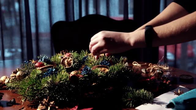 Crop hands making Christmas decor video