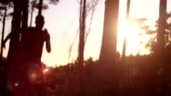 Cropped sun flare shot afro-american athlete sprinting past video