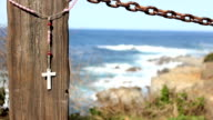 Cross Blowing On Fence By The Ocean At Big Sur video