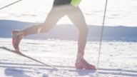 Cross country skier gliding on skiing track in idyllic landscape video