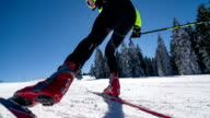 Cross country skier skate skiing uphill, warming up video