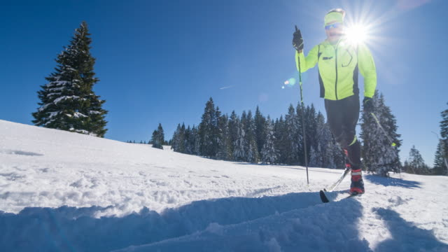 Cross country skiing on a parallel grooved ski track video