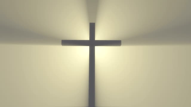 Cross in the fog with beams of light video
