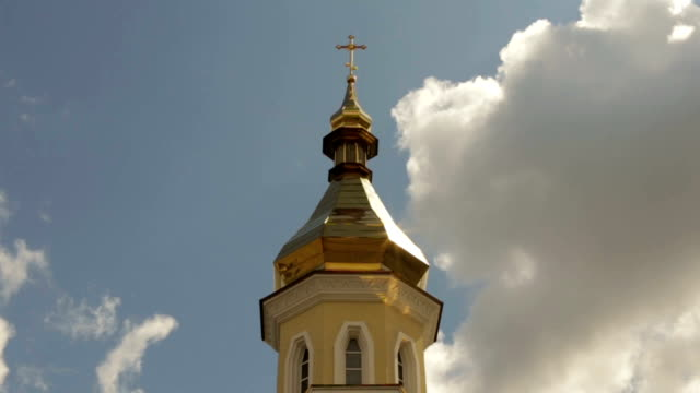 Cross on a church dome on a cloudy sky background video