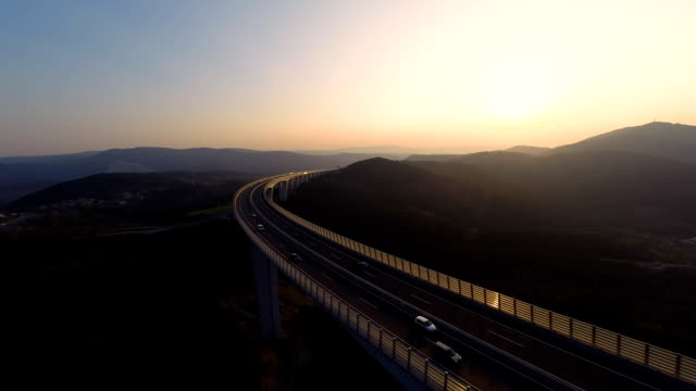 HD HELI: Crossing A Viaduct At Sunset video