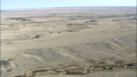Crossing Arid Landscape By South Crow Creek  - Aerial View - Wyoming, Laramie County, United States video