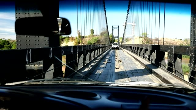 crossing old famous eiffel bridge over madagascar river video