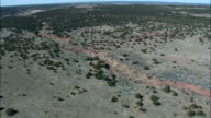 Crossing Zuni Indian Reservation Into Arizona  - Aerial View - New Mexico,  Cibola County,  United States video