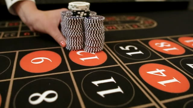 Croupier moves chips on table at casino video