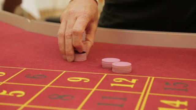 Croupier shuffling casino chips video