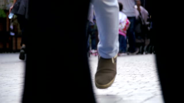 Crowd Anonymous People Walking on the Street. Crowd Feet. Slow Motion video
