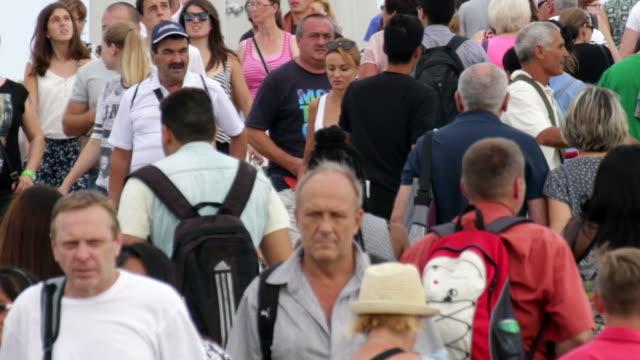 Crowd Crossing Maremagnum Bridge in Barcelona video