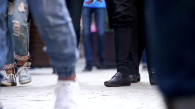 Crowd Feet of People Walking on the Street. Slow Motion video