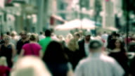 Crowd of anonymous shoppers, summer, shopping, walking, city, slow motion video