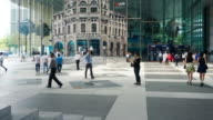 4K LS,TL Crowd of business people walking back and forth in Singapore Central Business video