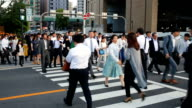 Crowd of Commuters Crossing a Busy Road in Osaka Japan video