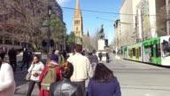 Crowd of people crossing road video