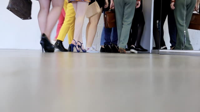 Crowd of people quits dancing class and goes in direction of dressing room video