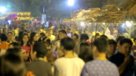 crowd of people waking on night market in Thailand video