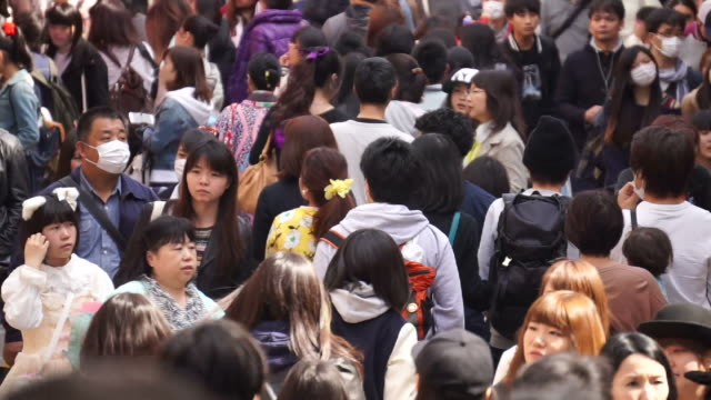 Crowd of people walking in a busy street in Tokyo video