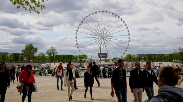 Crowd of people walking through the Tuileries Garden in Paris, France video