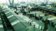 Crowd of travelers at airport terminal check-in area video