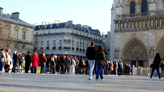 Crowd Queing at Notre Dame Cathedral Paris France video