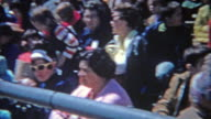 1963: Crowd seated watching high school track meet during bright summer day. video