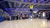 Crowd walking at international airport video