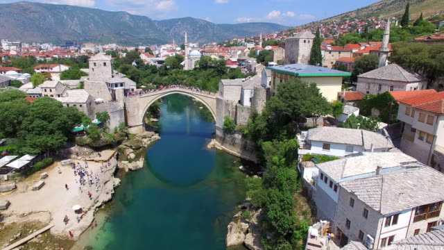 Crowd watching people jumping of the bridge in Mostar video