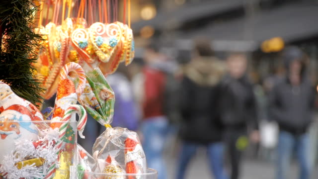 Crowded Belgrade street. People walking, rush hour, autumn. Focus on street sales mans decoration candy video