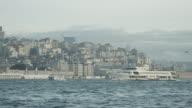 Crowded ferry boat docking along a busy Bosphorus strait harbor / Istanbul, Turkey video
