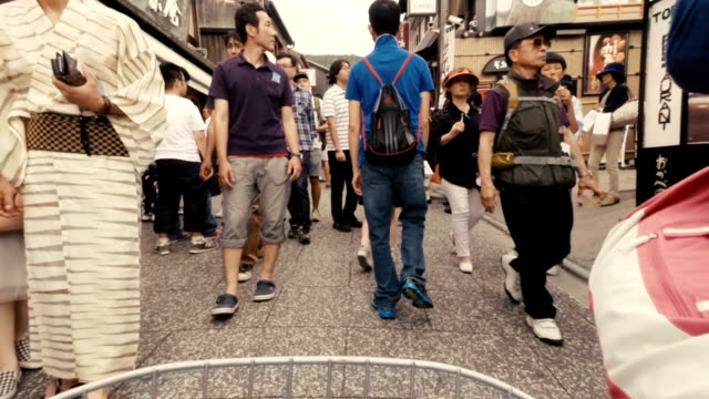 Crowded Pedestrians and Geishas in the Gion Area of Kyoto Japan video