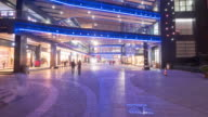 crowded people on marble floor before entrance of modern business building. timelapse 4k hyperlapse video