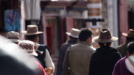 Crowded people praying and walking at Tibet video
