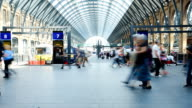 Crowded people train station, King's Cross St. Pancras in London, time lapse video