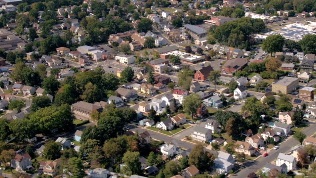 AERIAL: Crowded suburban town in rich neighborhood on the edge of New York video