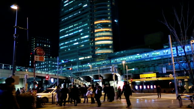 Crowds across road near akihabara station. video
