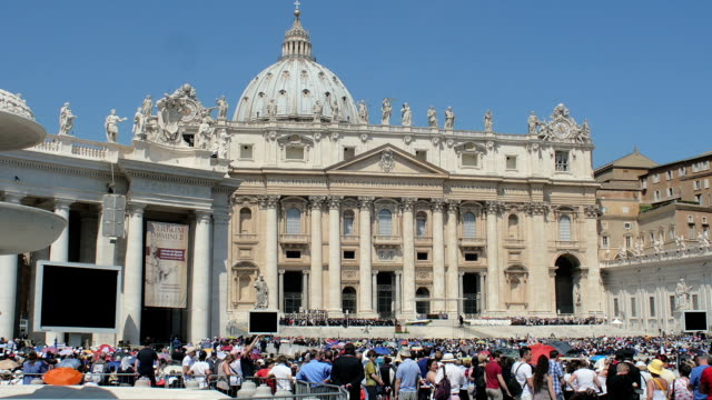 Crowds of tourists and pilgrims attend infront of the Cathedral of St. Peter. video