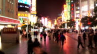 crowds,walking street and commercial buildings exterior in shanghai,time lapse. video