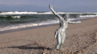 Crucified Jesus Christ without a cross placed on the beach video
