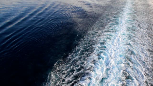 Cruise liner trace on water surface of sea video