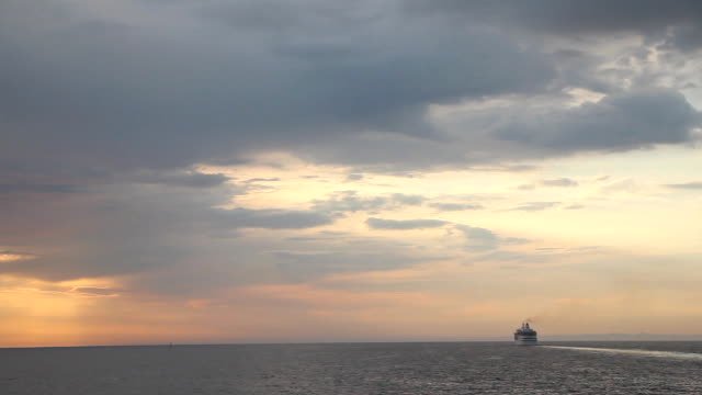 Cruise ship leaves at sunset video