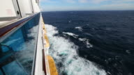 Cruise ship wake and blue sea from external side cabin video
