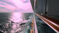 Cruise ship wake and pinkish sky from external side cabin video