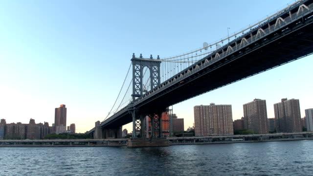 HYPERLAPSE: Cruising under the iconic historic Manhattan Bridge at golden sunset video