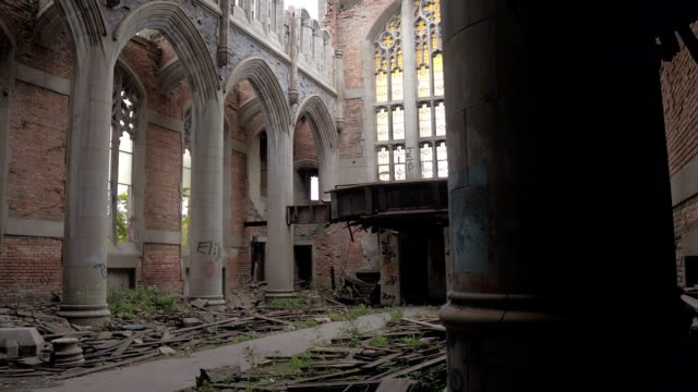 CLOSE UP Crumbling chancel and nave in ruined sanctuary at City Methodist Church video