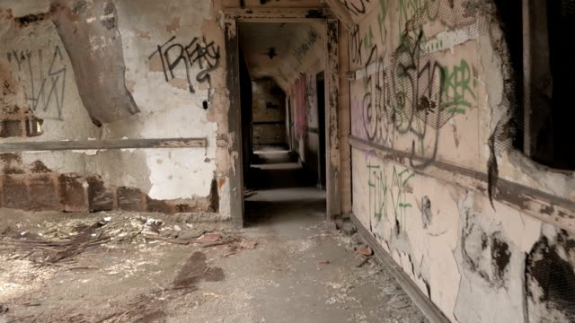 CLOSE UP: Crumbling corridor and decaying small attic rooms in abandoned house video