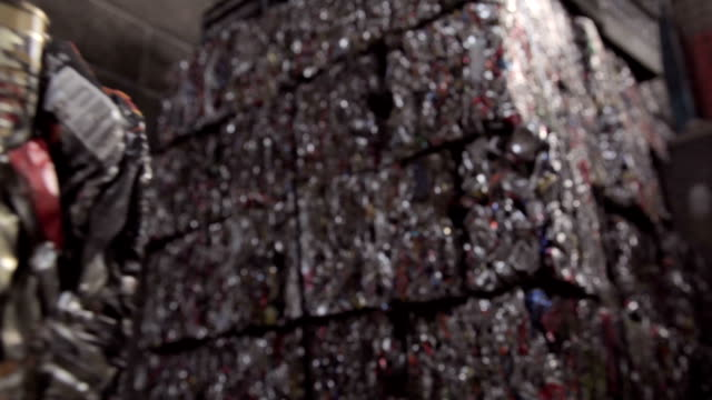 Crushed cans in cubic bales stacked up video